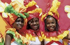 Photograph:Children dress in colorful costumes for a carnival celebration in Trinidad and Tobago.
