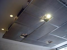 The entrance ceiling of this New York City building is adorned with multiple layers of Banker Wire architectural woven metal fabrics FPZ-46, P-278, and PZ-7. The different textures and weights created by the layers of wire mesh are held by suspension rods and standoffs. The layering of wire mesh can be an effective design tool to create a one of a kind architectural display. Product(s) Used: FPZ-46, P-278, PZ-7