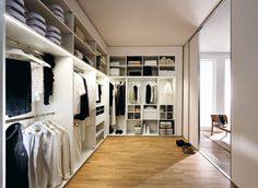 Like this, but maybe convert some of the open spaces to drawers. Like the use of floor to ceiling.
