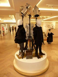 Mannequins on the window display in the fashion shop. Great example of visual…