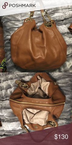 Michael Kors Tan leather purse Great condition! Has 3 compartments, middle section is zippered! Michael Kors Bags Shoulder Bags