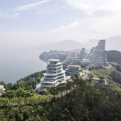 MAD has finished work on a suite of terraced housing towers bound by the shores of Taiping Lake and the granite peaks of the Huangshan mountain range in China's Anhui province.