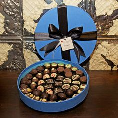 The Chocolate Tiers Indulgence Truffels Hamper A show stopping centre piece filled with 50 delicious truffles for an Indulgent festive treat. Assorted chocolate truffles and dipped fruits. Centre Pieces, Chocolate Truffles, Hamper, Christmas Gifts, Treats, Fruit, Breakfast, Festive, Gift Ideas