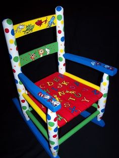 """I love to paint anything Dr. Below is a rocking chair featuring """"The Cat in the Hat,"""" """"Hop on Pop,"""" """"Dr."""