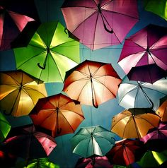 "Flickr photographer Patrícia Almeida recently shot these great photos of a wonderfully whimsical umbrella installation using her iPhone and camera. Like something out of a fairy tale, the umbrellas look almost like they're magically floating in mid-air. As she writes, ""In July in Águeda (a Portuguese town) some streets are decorated with colorful umbrellas. I felt like a kid, amazed by all that color!"" Love this kind of outdoor art."