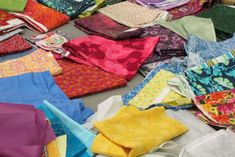 Fabric donation area at Quilt Expo's Quilt to Give community service project. Bring your quilt for donation and/or scraps in bright colors (no smaller than 1/4 yds.) for the community quilt attendees will stitch during Quilt Expo. Quilts will be donated to people in communities recently affected by devastating natural disasters.