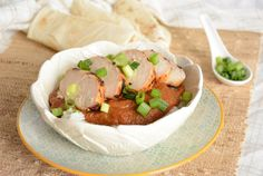 http://www.cookingandbeer.com/2013/09/chicken-and-rice-with-pumpkin-mole-sauce/