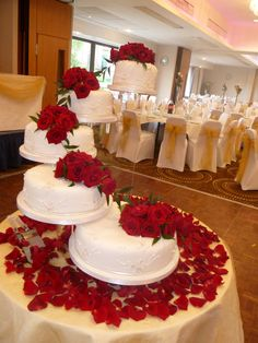 Stair case of cakes with roses.