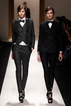 """Typically, the three-piece suit is tailored to the masculine """"V"""" silhouette. With a fitted vest, cigarette pant, and daringly tailored jacket, the women's figure looks powerful and chic."""