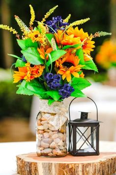 rustic wedding with a beautiful barn and a sunflower theme / http://www.himisspuff.com/rustic-wedding-centerpiece-ideas/14/
