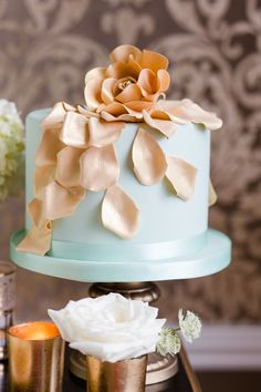 Soft golden peach floral details. See more from Cakes by Krishanthi on http://www.StyleMePretty.com/little-black-book-blog/2014/04/02/wedding-cake-inspiration-from-cakes-by-krishanthi/ -  CakesByKrishanthi.co.uk -  EddieJuddPhotography.com