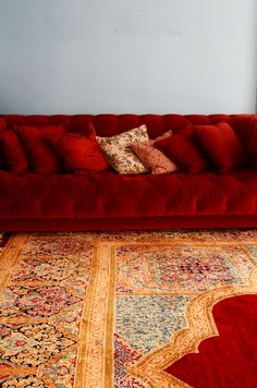 Boho // Burgundy tufted sofa