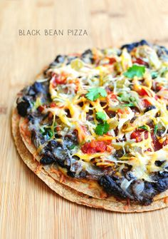 These lightened up Mexican Black Bean Pizzas are quick and easy, and are a great appetizer when cut into small pieces.