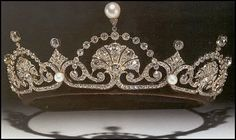 The Papyrus or Lotus Flower Tiara:  Princess Margaret's son, David, Viscount Linley, married The Honorable Serena Stanhope on 8 November 1993. The bride wore a gown evocative of her mother-in-law's wedding dress, along with the Papyrus or Lotus Flower tiara.  The tiara was acquired by Queen Mary and given to Queen Elizabeth the Queen Mother, who gave it to Princess Margaret.