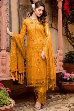 Look elegant when wearing this mustard yellow georgette trouser suit which will be scene-stealing ethnic wear to shine in the spotlight. This round neck and full sleeve suit highlighted with thread and sequins work. Paired with santoon straight pants in mustard yellow color with mustard yellow nazneen dupatta. Straight pants has sequins and thread work. #trousersuit #salwarkameez #malaysia #Indianwear #Indiandresses #andaazfashion Pakistani Suits Online, Pakistani Dresses, Indian Dresses, Indian Outfits, Eid Dresses, Lehenga Choli, Salwar Kameez, Elegant Dresses, Beautiful Dresses