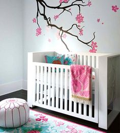 Baby Nursery : Baby Girl Nursery Ideas Asian Themed Wall Mural Revel Pink Flowers Feminim Patters White Crib Floral Motif Rug White Pink Stripes Line Pouffe Pink Floral Towel Blue Polka Dot Pillows Simple and Easy to Apply Baby Nursery Ideas Comfortable Baby Nursery Design. Comfortable Room. Baby Nursery Idea.