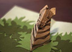 Craft Of The Day: Pop-Up Zebra Card--made from the Robert Sabuda reindeer pop-up minus the antlers: http://wp.robertsabuda.com/pop-make-reindeer/