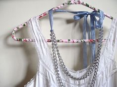 Fabric covered plastic hangers tutorial. Fantastic idea. I have tons of those and hate the look of plastic.