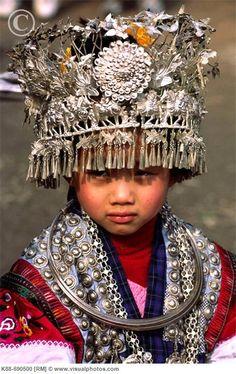 Miao child (Chinese minority people) metal headdress