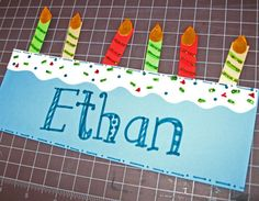 """Birthday Headband.  cut a piece of white cardstock into  1.5 X 8.5 strips. Then I use my scissors and cut a squiggly line down the middle. Now I have 2 icing strips.   Glue an icing strip on top of the cake.  all of those 2-inch strips that you have leftover can be cut into candles 1/2"""" wide.  Cut flames from orange paper.  Decorate with glitter glue.  Add a strip to fit their head."""