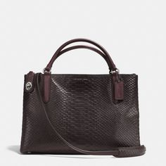 "The Turnlock Borough Bag In Python Embossed Leather from Coach :: COLOR: BLACK ANTIQUE NICKEL/OXBLOOD :: Handles with 4 3/4"" drop Adjustable strap with 18"" -21"" drop 13 3/4"" (L) x 9"" (H) x 5 1/2"" (W) / 35 cm (L) x 23 cm (H) x 14 cm (W)"