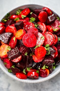 This maple roasted beets and carrots recipe is an easy, colorful, and healthy side dish. Perfect for your holiday table! #roastedbeets #roastedcarrots #Thanksgivingside #sidedish