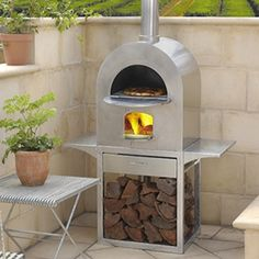 This is probably the sort of oven we would want – something to take when we move    Nectre Pizza Oven – stocked B'rat @ Haymarket?; Wignell's Abbotsford; Just Flues Thomastown  no base $2700 (would need to put on brickwork), with base $3100