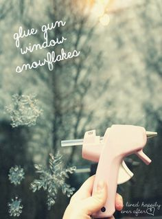 Use a Low Temperature Hot Glue Gun to Make Snowflakes on your Windows! You can even do spiderwebs for Halloween too! Just check the post for all the tips.