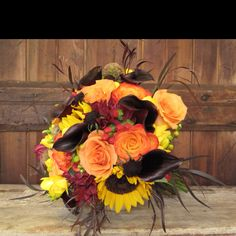 i will have this as my bridal bouquet...sunflowers to represent my grandfather and all of his favorite colors...