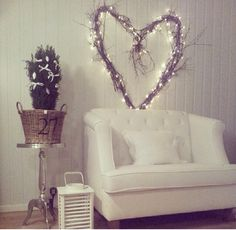 """Heart Made of Entwined Twigs with Fairy Lights. The only way I've yet seen to hide the """"extra"""" lights as it goes down the wall to the plug."""
