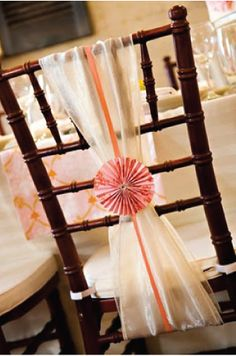 We could do something like this with tulle and a small piece of lace or pink bow. If like chair covers get pricey