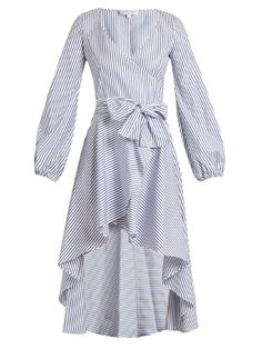Caroline Constas puts fresh twists on classic shirting fabric, as this Lena dress demonstrates. It's crafted in the USA from blue and white striped cotton, and has a plunging V-neck and cinching waist tie that are balanced by the feminine blouson sleeves and cascading asymmetric hemline. Colour-pop heels will keep the look contemporary.