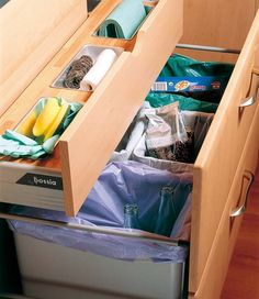 This 3 can trash drawer to separate compost, recyclables, trash is even better bc it has a compost one! This drawer with the pull out cutting board with the hole to go over the compost one!!