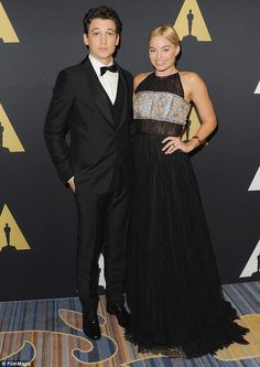 Co-presenter: Margot Robbie was joined by Divergent star Miles Teller who looked suave in a tuxedo.