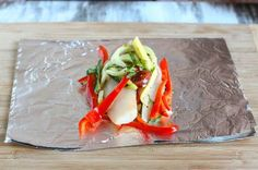 Bake tilapia with fresh veggies in a foil packet for 15 minutes...easy and healthy.