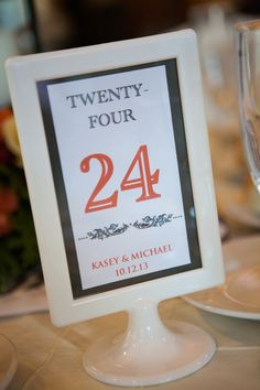 We made our own table numbers with these frames from ikea 99 cents...... fall wedding orange and gray
