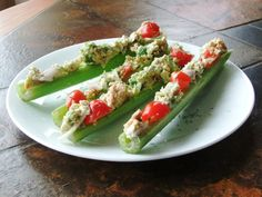 Tuna Salad Celery Boats - I would make them with chicken salad, dried cranberries, grapes and almonds!  YUM!