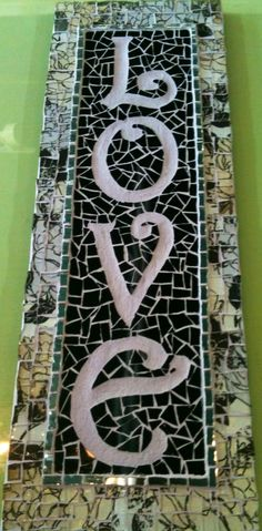 mosaic LOVE sign. Love the dig out lettering