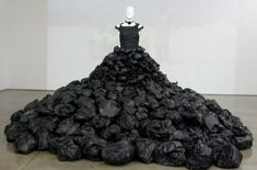 Bags puffed up for dramatic skirt, but with more of a flowing effect and less just looking like a pile of trash bags | Jum Nakao, Garbage Bag Dress
