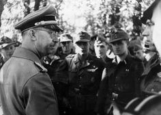 Heinrich Himmler is seen here in conversation with men of the 12. SS Panzer Division Hitlerjugend in France in the spring of 1944.