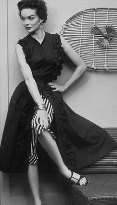 Stripes, ruffles and thin bangles add up to a cool, subtly artsy 1950s warm weather look. #vintage #fashion #1950s