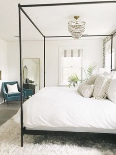 canopy bed with white bedding. White bedroom ideas, all white bedrooms, guest bedrooms that wow, guest bedrooms that make an impression, AirBnb bedroom ideas. how to have a hotel-like bedroom. clean…More How To Create A Modern Bedroom Home Decor Bedroom, All White Bedroom, Bedroom Inspirations, Home Bedroom, Bedroom Interior, Bedroom Styles, Master Bedroom Remodel, Guest Bedrooms, White Bedroom