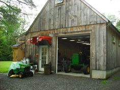 Jeep CJ5 awning over garage door.  John Deeres in the barn.  Awesome idea!