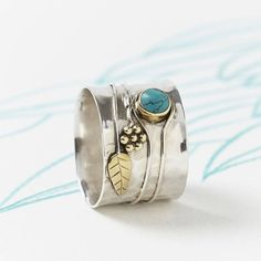 Handmade Turquoise Flower Silver Ring. A statement, handmade Turquoise Silver Ring with a nature inspired flower and leaf design. | Modern Boho