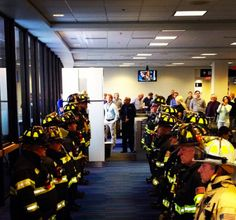 American Military  Fire fighters gather at Logan Airport as a mother of one of the fallen Boston fire fighters was arriving for her son's funeral. Everyone in America should see this photo!  God bless all of our first responders, especially the two Boston fire fighters lost this week. https://www.facebook.com/AmericanMilitary/photos/a.10150182911185465.340984.190386180464/10152283141690465/?type=1