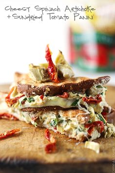 Tasty grilled sandwiches with a roasted artichoke, spinach, and sundried tomato spread topped with gooey provolone cheese!