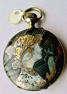 Very Rare Art Nouveau Longines Niello Pocket Watch with Woman's Face - Circa 1900. Black enamel over sterling silver (.900) with 18kt gold overlay in some areas. The watch works well when wound daily and keeps accurate time.: http://www.rubylane.com/item/603650-5113/Very-Art-Nouveau-Longines-Niello