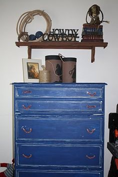 Cowboy themed room. Thinking light blue walls with dark wood & rope accents. (Cute storage idea here.)