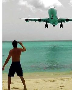 This is how planes land in Saint Maarten.  You can stand on the beach and FEEL the power of the engines.  It literally knocks you down!