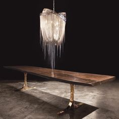 Knight Base Dining Table by Hudson Furniture - live edge walnut and bronze base